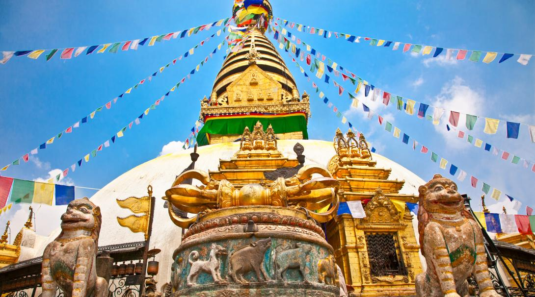 A view of Swayambhunath Stupa as travellers climb up the hillside in Nepal.